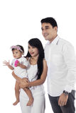 Attractive asian family in studio Royalty Free Stock Photo