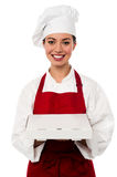 Attractive asian female chef delivering pizza Stock Images