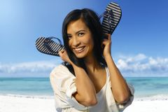 Attractive Asian girl on the coastline Stock Photography