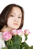 Attractive asian girl with flowers Royalty Free Stock Photo