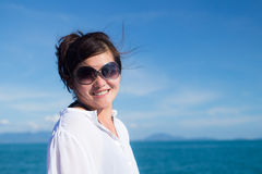 Attractive asian girl relaxing on a yacht Royalty Free Stock Photo
