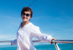 Attractive asian girl relaxing on a yacht Stock Photos