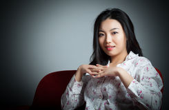 Attractive Asian girl 20s at the theatre isolate white backgroun Royalty Free Stock Photography
