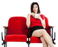 Attractive Asian girl 20s at the theatre isolate white background Royalty Free Stock Images