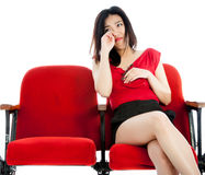 Attractive Asian girl 20s at the theatre isolate white background Royalty Free Stock Image