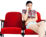 Attractive Asian girl 20s at the theatre isolate white background Stock Photography
