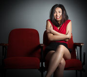 Attractive Asian girl 20s at the theatre isolate white background Royalty Free Stock Photography