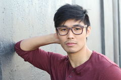 Attractive Asian man with glasses close up portrait Royalty Free Stock Photo
