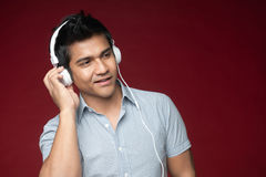 Attractive Asian Man hearing music Stock Image
