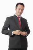 Attractive asian man in suit over white background Stock Image