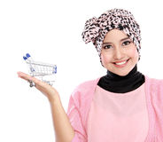 Attractive asian muslim woman with shopping cart Royalty Free Stock Image