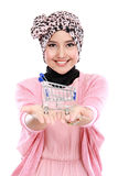 Attractive asian muslim woman with shopping cart Stock Image