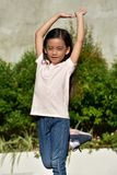 Cute Asian Child Stretching stock photo