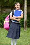Happy Catholic Student Child Wearing School Uniform With Books
