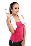 Attractive asian smiling woman drinking water Royalty Free Stock Photography