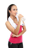 Attractive asian smiling woman drinking water Stock Images