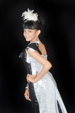 Attractive asian teenage girl. Wearing glamour clothes on black background Stock Images