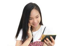 Attractive Asian woman Applying Her Makeup Stock Photos