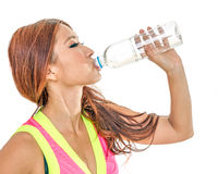 Attractive Asian woman drinking water after workout stock images