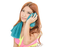 Attractive Asian woman drying with towel after exercise stock photo
