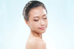 Attractive asian woman with eyes shut royalty free stock images