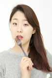 Attractive asian woman with fork Stock Images