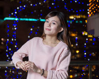 Attractive Asian Woman in front of bright LIghts Stock Photography