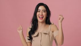 Free Attractive Asian Woman Having Fun Smiling And Dancing In Studio. Royalty Free Stock Photos - 125551408