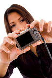Attractive asian woman holding camera Stock Photo
