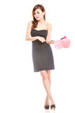 Attractive Asian woman holding make-up bag Royalty Free Stock Images