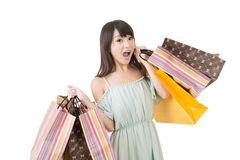 Attractive asian woman holding shopping bags. With exciting face. Portrait isolated on the white background Royalty Free Stock Photos