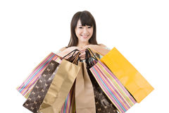 Attractive asian woman holding shopping bags. With exciting face. Portrait isolated on the white background Stock Photo