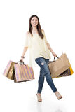 Attractive asian woman holding shopping bags. Full length portrait. Isolated on the white background Royalty Free Stock Photos