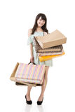 Attractive asian woman holding shopping bags. Full length. Portrait isolated on the white background Royalty Free Stock Photography