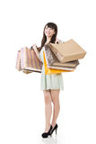 Attractive asian woman holding shopping bags. Full length. Portrait isolated on the white background Royalty Free Stock Photos