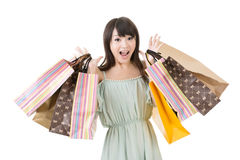 Attractive asian woman holding shopping bags. Portrait isolated on the white background Stock Photos