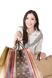 Attractive asian woman holding shopping bags. And posing in studio. Half length portrait. Isolated on the white background Royalty Free Stock Images