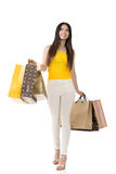 Attractive asian woman holding shopping bags. And walking in studio. Full length portrait. Isolated on the white background Stock Photography