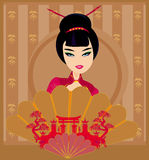 Attractive asian woman holding traditional fan Stock Photo