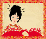 Attractive asian woman holding traditional fan. Illustration Stock Photo