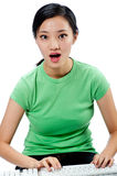 An attractive Asian woman with keyboard Stock Images