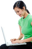 An attractive Asian woman with laptop Stock Photography