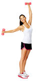 Attractive asian woman lifts dumbbells overhead, Royalty Free Stock Image