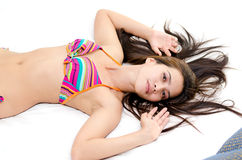 Attractive Asian woman lying down in bed Royalty Free Stock Photo