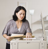 Attractive asian woman making copy. Stock Photo