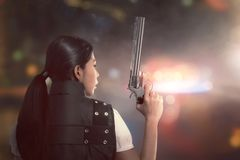 Attractive asian woman police with uniform with a guns Stock Images