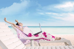 Attractive woman relaxing at beach Royalty Free Stock Image