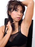 Attractive Asian woman runs a hand through her hair Royalty Free Stock Image
