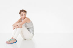 Attractive asian woman sit on ground Stock Images