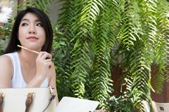 Asian woman sit at outdoor cafe. young female adult with natural Stock Photography